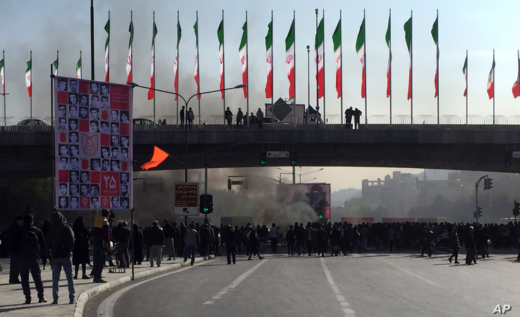 Smoke rises during a protest after authorities raised fuel prices, in the central city of Isfahan, Iran, Nov. 16, 2019.