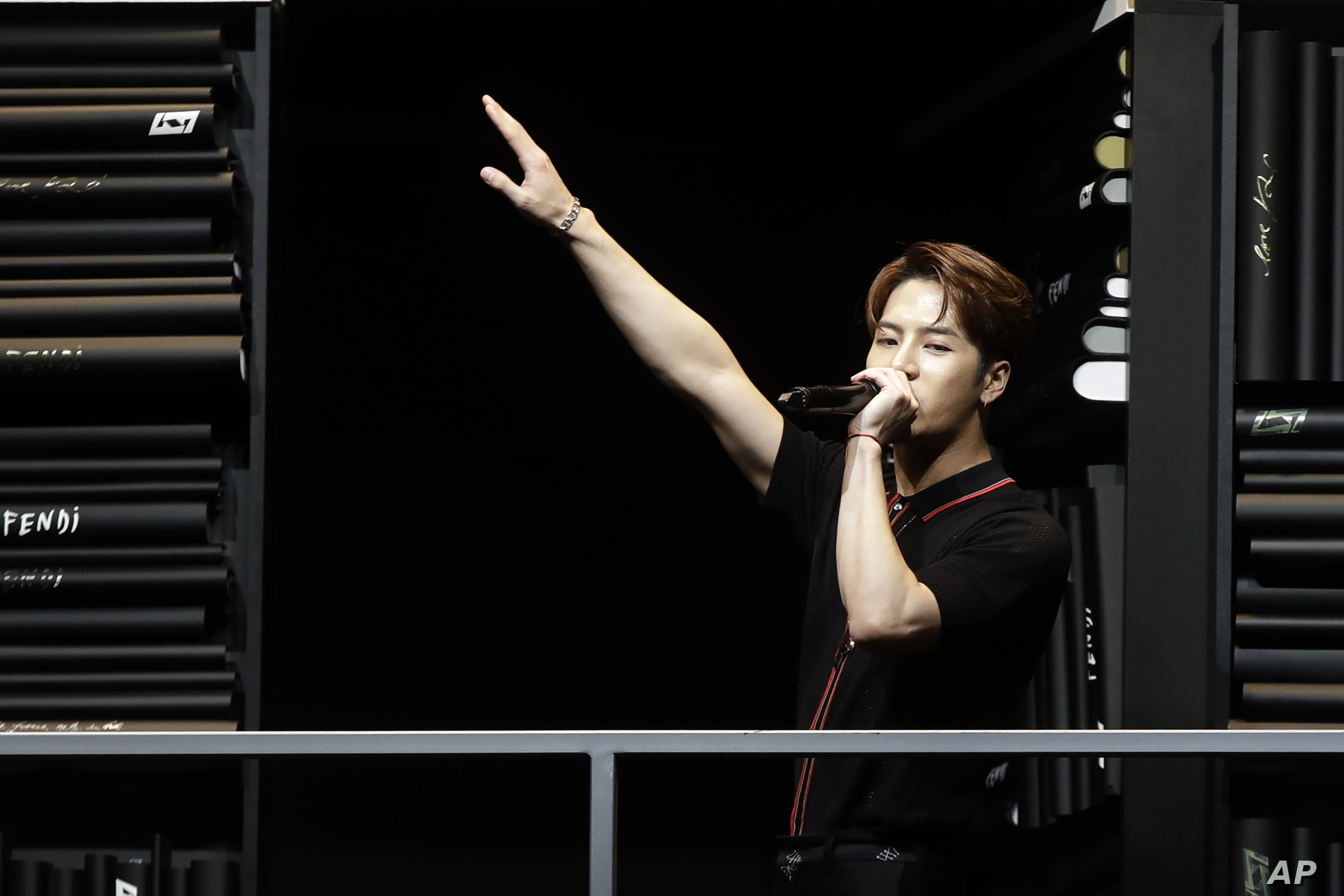FILE - In this Jan. 14, 2019, file photo, singer Hong Kong singer Jackson Wang performs at the end of the Fendi men's Fall-Winter 2019-20 collection, that was presented in Milan, Italy. At least eight K-pop stars from China and even one from Taiwan…